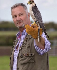 John Snellin with falcon on fist